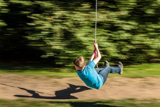 image: boy on swing